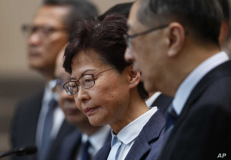 Hong Kong Chief Executive Carrie Lam, center, reacts during a press conference in Hong Kong, July 22, 2019.