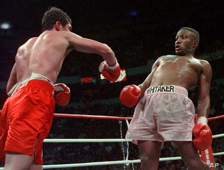FILE - Pernell Whitaker, right, leans away from a punch by Oscar De La Hoya during their WBC Welterweight Championship fight at Thomas & Mack Center in Las Vegas, April 12, 1997.