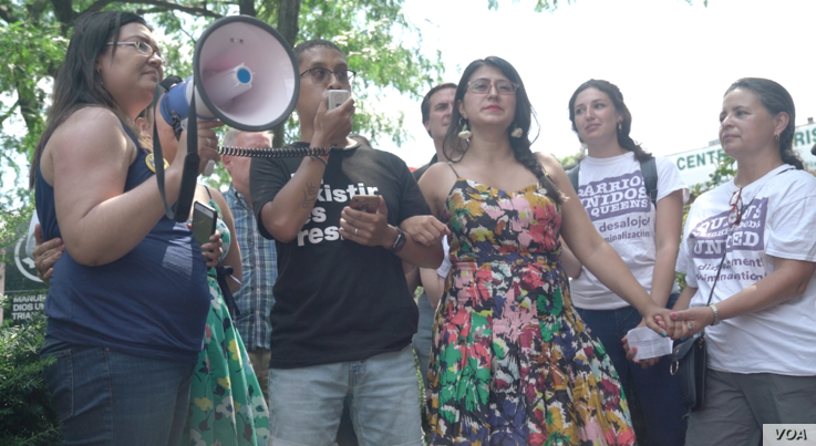 Queens Neighborhoods United rallied more than 100 people for an immigration march, July 14, 2019, through the Jackson Heights neighborhood of the Queens borough of New York to protest the Trump administration's raids to sweep up illegal immigrants.