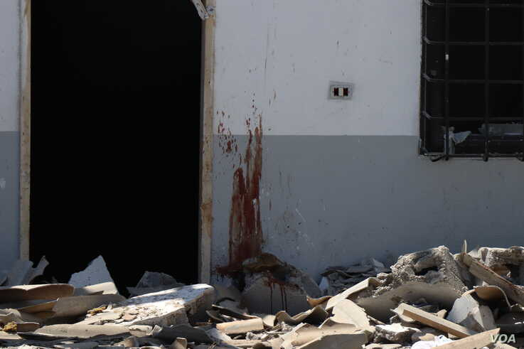 The U.N. says the bombing could amount to a war crime and has called for an investigation on July 3, 2019 in Tripoli, Libya. (H.Murdock/VOA)