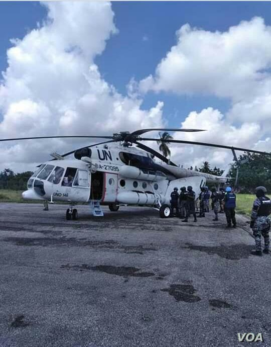Arnel Joseph dressed and on a stretcher. UN helicopter prepares to transfer him to Port au Prince.