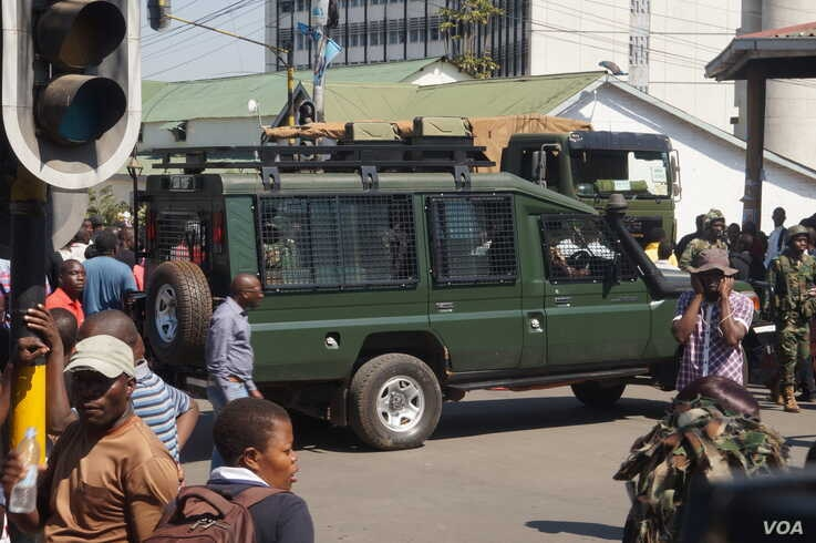 Military vehicles and soldiers were used to block the Presidential Drive in Blantyre, Malawi, July 25, 2019, to prevent the protesters from delivering petitions calling for Jane Ansah to resign as MEC chairwoman. (VOA/L. Masina)