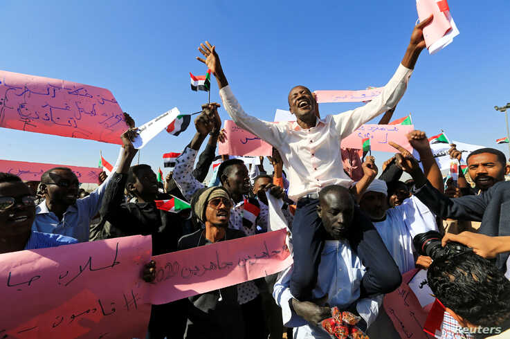 FILE - Supporters of Sudan's President Omar al-Bashir chant slogans to his favor during a rally at Green Square in Khartoum, Sudan, Jan. 9, 2019.