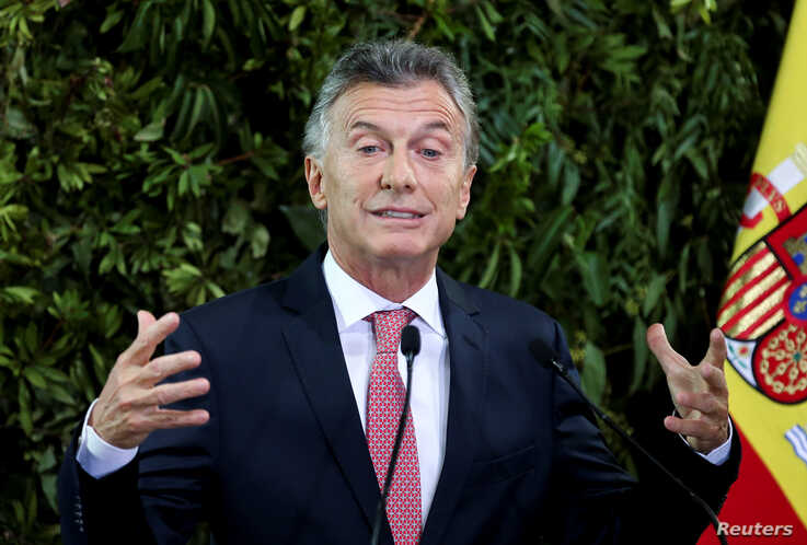 FILE - Argentina's President Mauricio Macri gestures as he gives a speech during a state dinner at the Centro Cultural Kirchner, in Buenos Aires, Argentina, March 25, 2019.