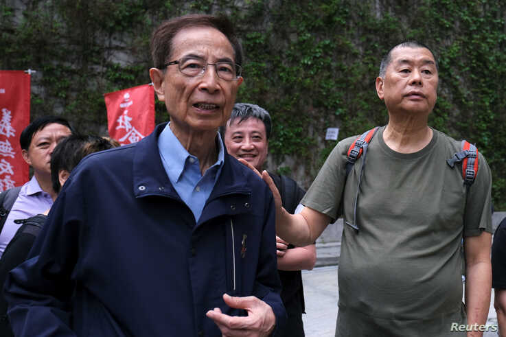 FILE - Hong Kong politician Martin Lee and founder of Next Media Jimmy Lai march during a protest to demand authorities scrap a proposed extradition bill with China, in Hong Kong, March 31, 2019.