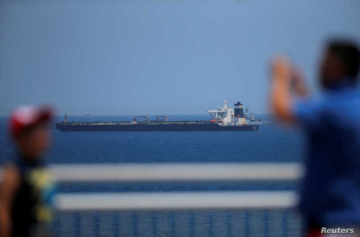 The oil supertanker Grace 1, that's on suspicion of carrying Iranian crude oil to Syria, sits anchored in waters of the British overseas territory of Gibraltar, historically claimed by Spain, July 4, 2019.