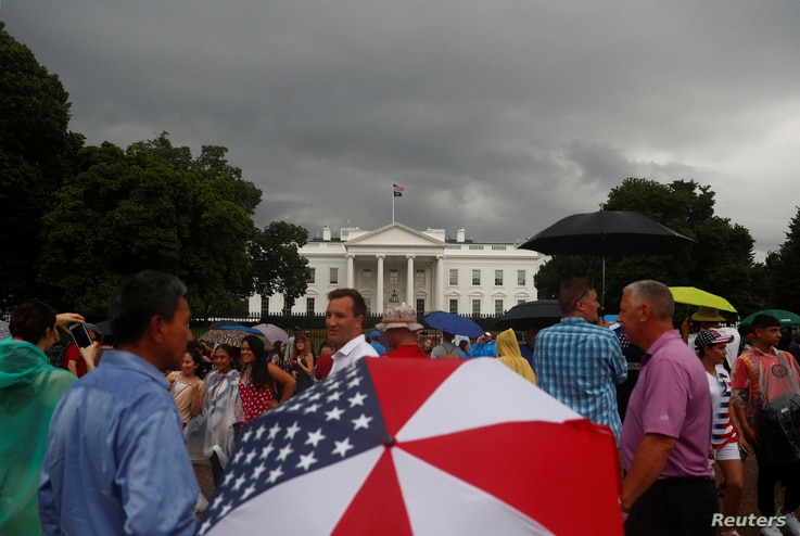 People gather in front of the White House during a Fourth of July Independence Day protest in Washington, D.C., U.S., July 4, 20