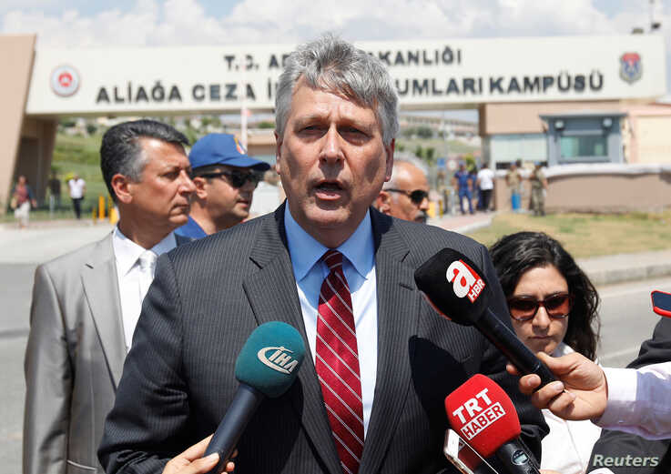 FILE - Philip Kosnett, then the U.S. charge d'affaires in Turkey, talks to reporters in Izmir, July 18, 2018.