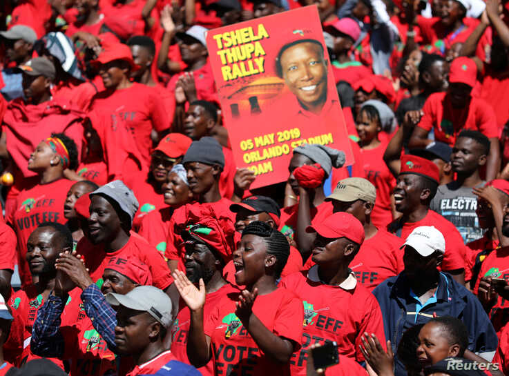 Supporters of Economic Freedom Fighters (EFF) party leader Julius Malema cheer at the party's final election rally ahead of the country's May 8 poll, in Johannesburg, South Africa, May 5, 2019.