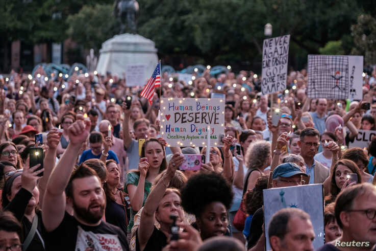 "Immigration rights activists hold a ""Lights for Liberty"" rally and candle light vigil in front of the White House in Washington,  July 12, 2019."