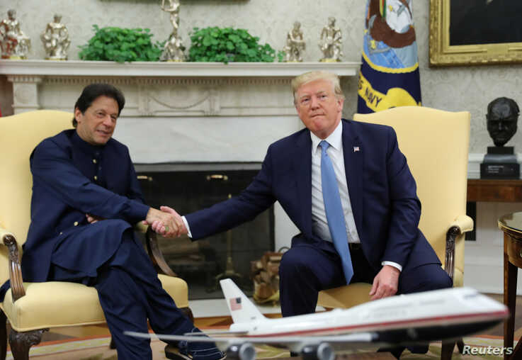 Pakistan's Prime Minister Imran Khan shakes hands with U.S. President Donald Trump at the start of their meeting in the Oval Office of the White House in Washington, July 22, 2019.