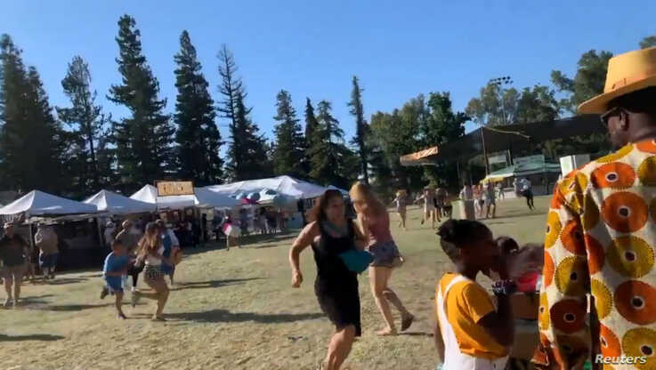 People run as an active shooter was reported at the Gilroy Garlic Festival, south of San Jose, California.