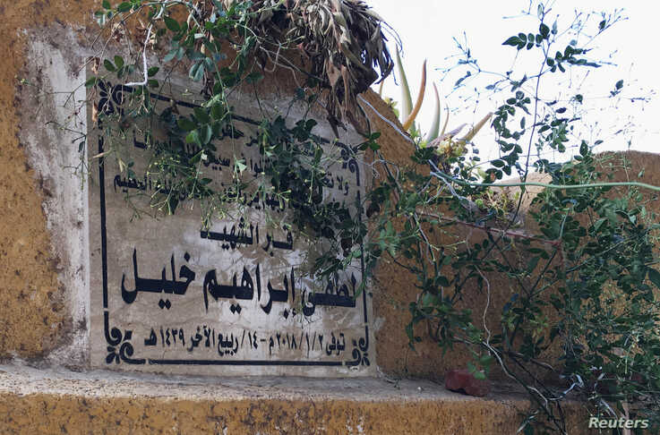 FILE - The headstone of Lotfy Ibrahim's grave in Kafr al-Sheikh, Egypt, Jan. 13, 2019.