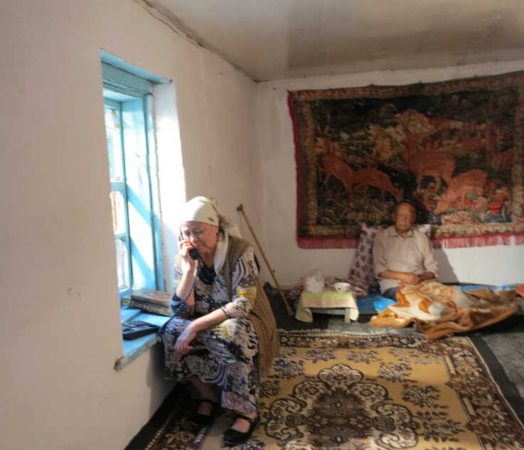 """Aziz Isa Elkun's mother talks to him by telephone in Xinjiang, China, in  """"An Unanswered Telephone Call."""""""