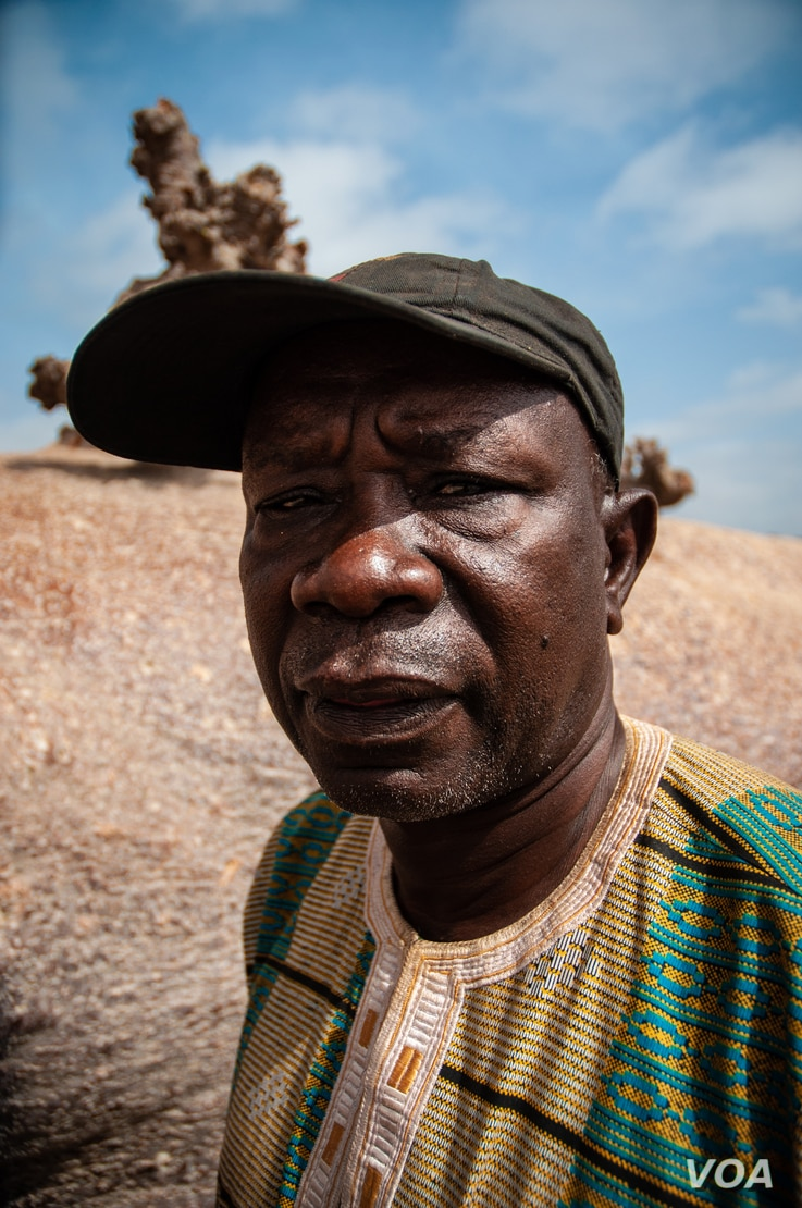 Sitor Diouf, the village chief of Guedj Martin, Senegal, poses for a portrait. (Annika Hammerschlag, for VOA)
