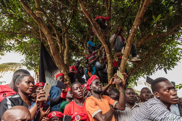 Supporters of Bobi Wine look on as he speaks at a news conference at his home in Kasangati, Kampala, Uganda, July 24, 2019.