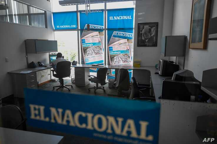 FILE - An employee works at a room of Venezuelan newspaper El Nacional in Caracas, Venezuela, June 14, 2019.