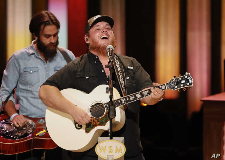 """Luke Combs performs at """"Luke Combs Joins the Grand Ole Opry Family,"""" at the Grand Ole Opry, Tuesday, July 16, 2019, in Nashville, Tenn."""