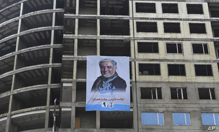 An electoral poster of current Afghan chief executive and presidential candidate Abdullah Abdullah is seen on a building under construction during the first day of campaigning in Kabul, Afghanistan, July 28, 2019.