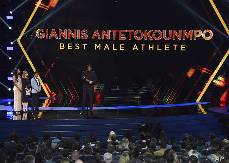 NBA player Giannis Antetokounmpo of the Milwaukee Bucks, accepts the award for best male athlete at the ESPY Awards, July 10, 2019, at the Microsoft Theater in Los Angeles.