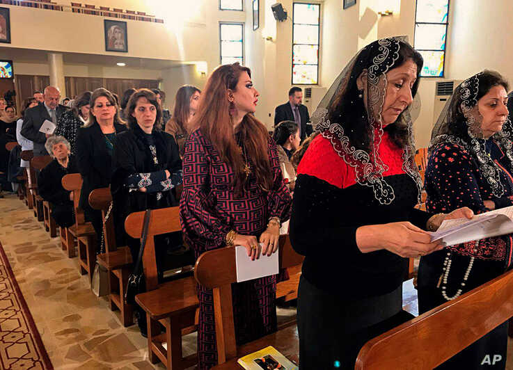 Iraqi Catholics pray during Mass at Mar Youssif Chaldean church, in Baghdad, Iraq, Dec. 25, 2018.