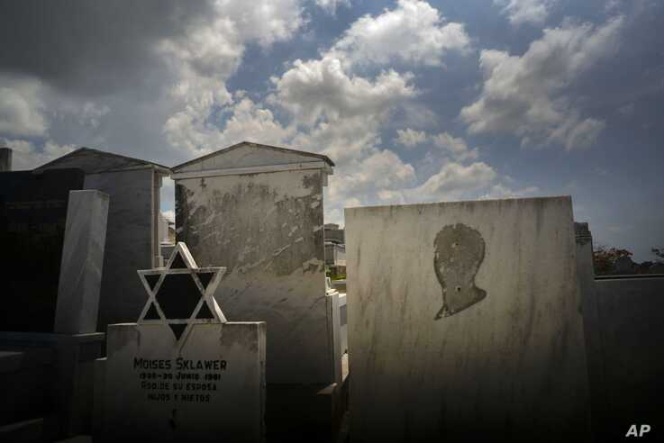 Tombs decorated with the Star of David, and one lacking the image of a person, stand in the Jewish cemetery in Guanabacoa, eastern Havana, Cuba, June 12, 2019.