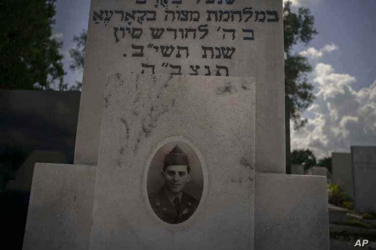 The portrait of a young Cuban soldier who died fighting in The Korean War decorates his tomb at a Jewish cemetery in Guanabacoa, eastern Havana, Cuba, June 7, 2019.