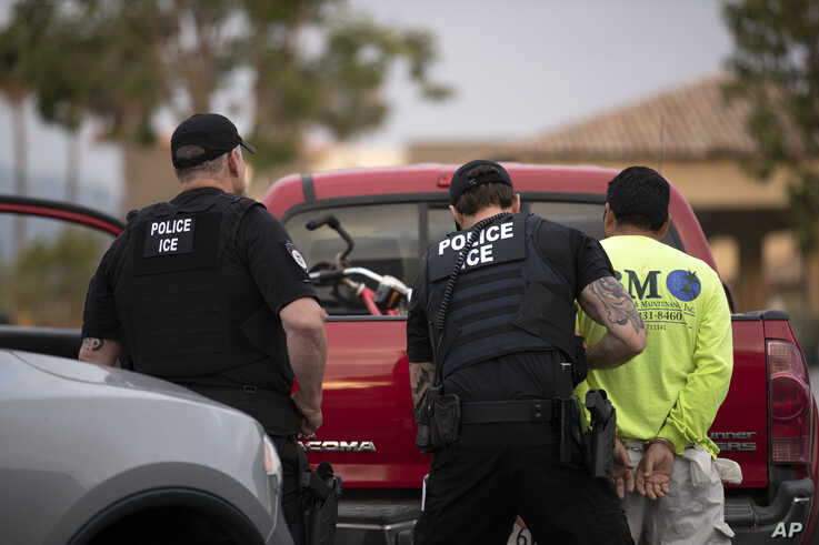 U.S. Immigration and Customs Enforcement (ICE) officers detain a man during an operation in Escondido, California, July 8, 2019.