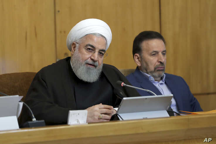 In this photo released by the official website of the office of the Iranian Presidency, President Hassan Rouhani speaks during a cabinet meetin in Tehran, July 10, 2019.