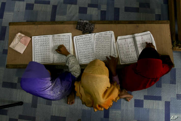 FILE - Rohingya Muslim children recite from the holy Quran at a school in Klang, on the outskirts of Kuala Lumpur, Malaysia, Sept. 12, 2017.