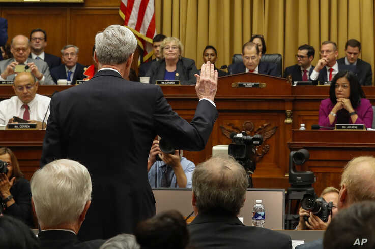 Former special counsel Robert Mueller is sworn in by House Judiciary Committee Chairman Jerrold Nadler, a Democrat, to testify before the Committee on his report on Russian election interference, on Capitol Hill, in Washington, July 24, 2019.