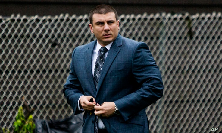 FILE - New York City police officer Daniel Pantaleo leaves his house in Staten Island, May 13, 2019.