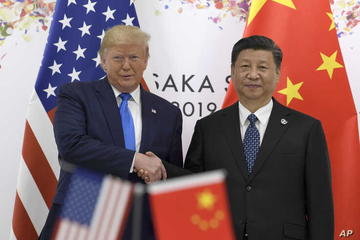 President Donald Trump, left, shakes hands with Chinese President Xi Jinping during a meeting on the sidelines of the G-20 summit in Osaka, Japan, June 29, 2019.
