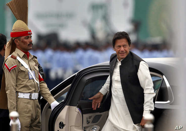 Pakistani Prime Minister Imran Khan arrives to attend a military parade in Islamabad, Pakistan, March 23, 2019.