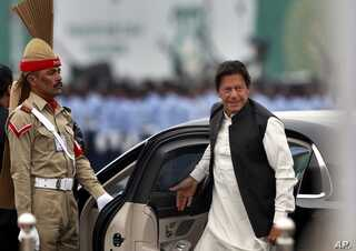 FILE - Pakistani Prime Minister Imran Khan arrives to attend a military parade in Islamabad, Pakistan, March 23, 2019.