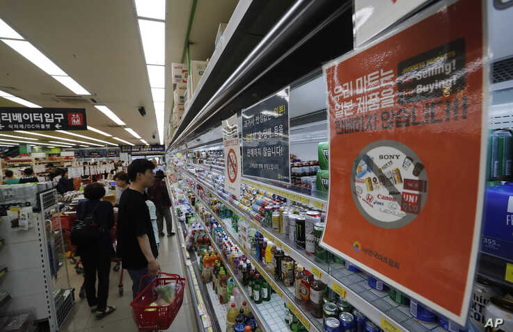 Notices campaigning for a boycott of Japanese-made products are displayed at a store in Seoul, South Korea, July 9, 2019.