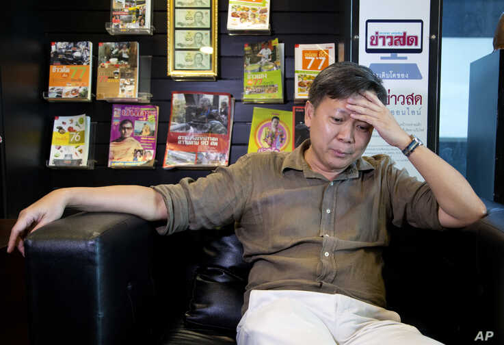 Thai journalist Pravit Rojanaphruk gestures during an interview with the Associated Press, in Bangkok, Thailand, May 10, 2016.
