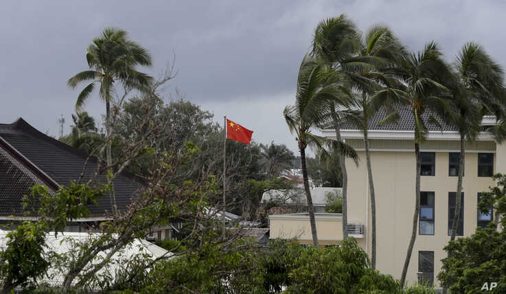 A Chinese flag flies outside the Chinese Embassy in Nuku'alofa, Tonga, April 8, 2019.