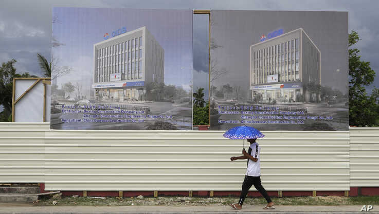 A man walks past a development site for a Chinese Investment bank in Nuku'alofa, Tonga, April 10, 2019.