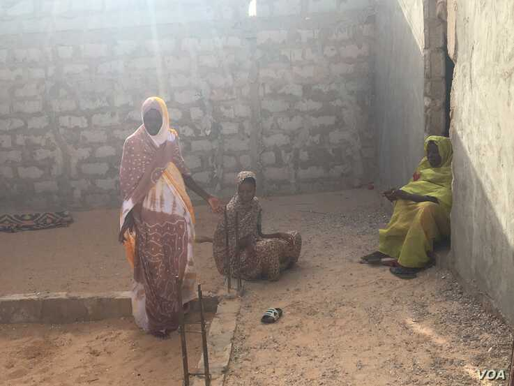 M'Barka and her family are still waiting for a court decision on their case, eight years after it was opened (E. Sarai/VOA)