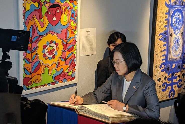 Taiwan's President Tsai Ing-wen signs the guest book during her visit to the Musée de Panthéon Nationale, in Port au Prince, Haiti, July 13, 2019. (@jovenelmoise Twitter)