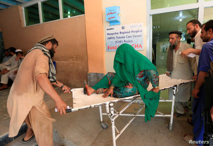 An injured woman receives a treatment at the hospital, after a roadside bomb blast in Jalalabad, Afghanistan, July 25, 2019..