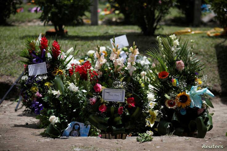 Flowers are seen where Oscar Alberto Martinez Ramirez and his daughter Valeria, migrants who drowned in Rio Grande river during their journey to the U.S., where buried at La Bermeja cemetery in San Salvador, El Salvador July 1, 2019.