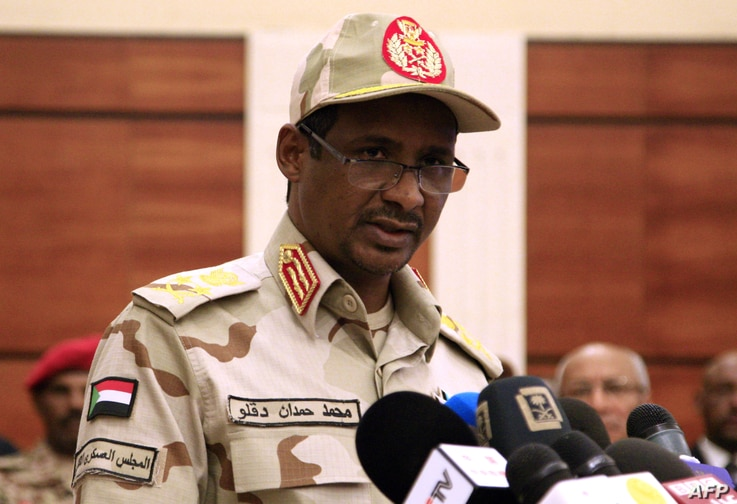 FILE - Sudanese deputy chief of the ruling miliary council Mohamed Hamdan Dagalo delivers a speech after inking an agreement with protest leaders in Khartoum, July 17, 2019.