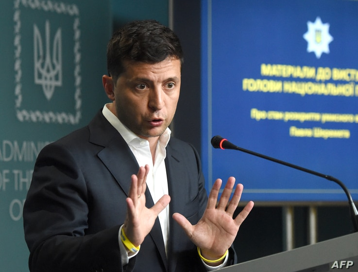 Ukrainian President Volodymyr Zelensky gestures as he speaks during a joint press conference held with the Chief of the Ukrainian National Police in Kyiv on July 23, 2019.