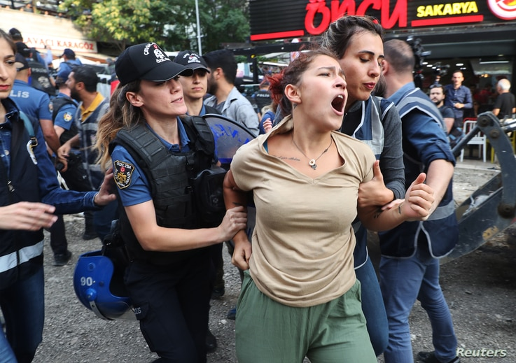 A protester is detained by police during a demonstration against the Turkish government's removal from office of three pro-Kurdish mayors on Aug. 19, 2019, in Ankara.