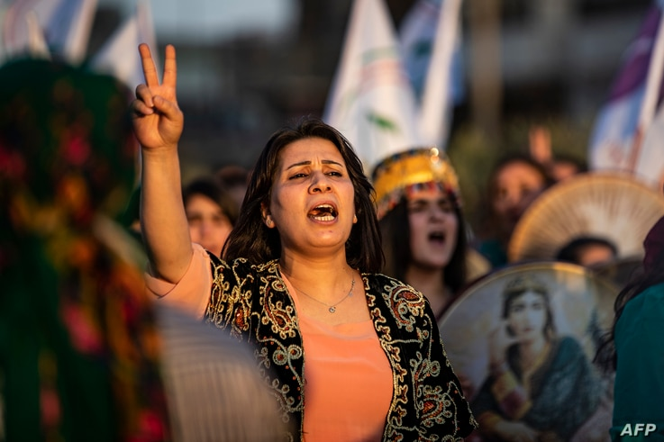 A Syrian Kurdish demonstrator shouts slogans during a protest against Turkish threats to invade the Kurdish region, in the northeastern city of Qamishli, Aug. 27, 2019.
