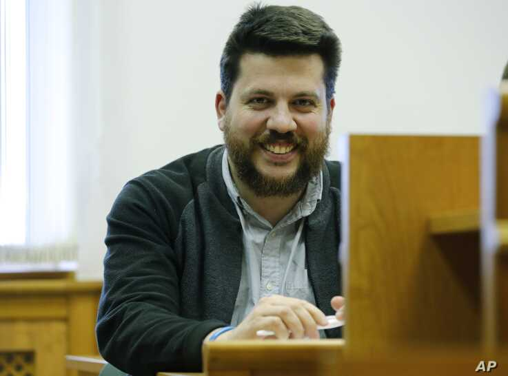 In this file photo taken on March 31, 2017,  leading associate of Russian opposition leader Alexei Navalny, Leonid Volkov smiles in a court room during a hearing in Moscow.