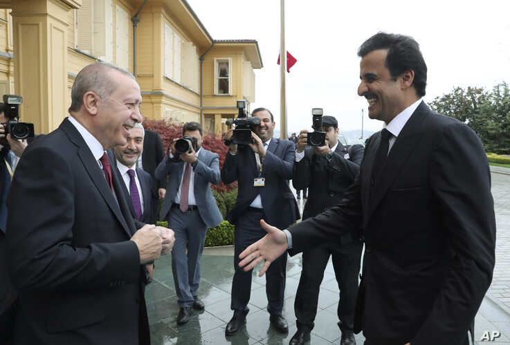 FILE - Turkey's President Recep Tayyip Erdogan, left, welcomes Qatar's Emir Sheikh Tamim bin Hamad Al Thani before their talks in Istanbul, Monday, Nov. 26, 2018.