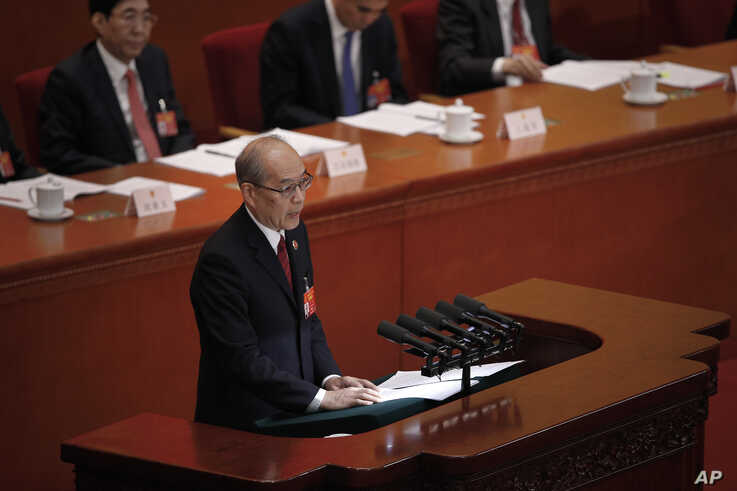 FILE - Zhang Jun, then-procurator-general of China's Supreme People's Procuratorate, delivers a report at the Great Hall of the People in Beijing, March 12, 2019.